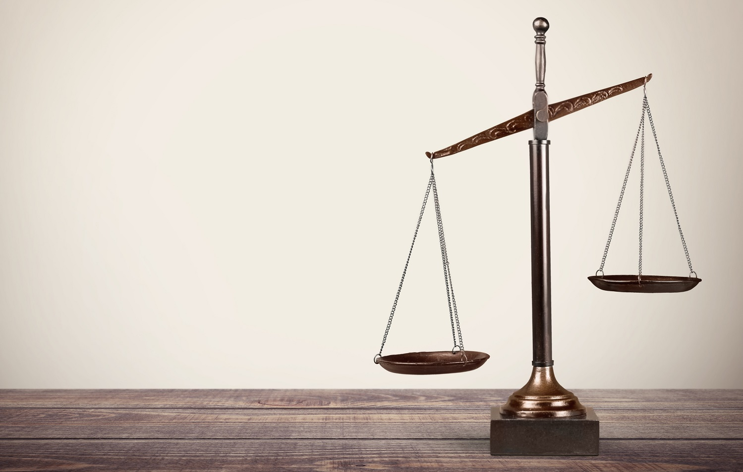 Lawyer. Law scales on table in front black background. Symbol of justice